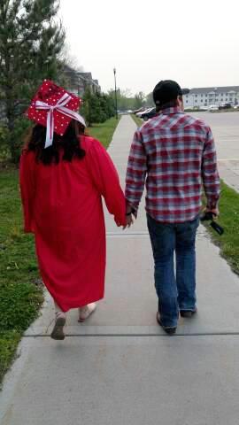 Jennifer and boyfriend Andrew walking to Graduation (taken by son Dustin)